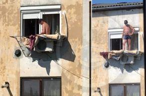 A negyedik emeleti ablakból mászott ki napozni - a légkondira